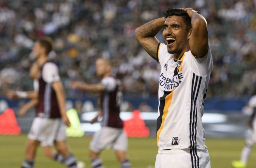 Jun 22, 2016; Carson, CA, USA; LA Galaxy defender A.J. DeLaGarza (20) reacts during the game against the Colorado Rapids during the first half at StubHub Center. Mandatory Credit: Kelvin Kuo-USA TODAY Sports