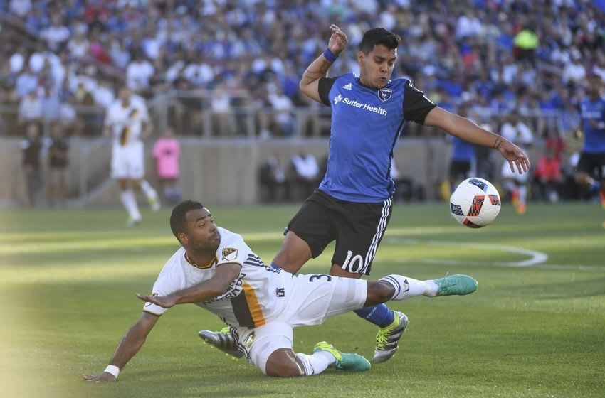 June 25, 2016; Stanford, CA, USA; Los Angeles Galaxy defender Ashley Cole (3) and San Jose Earthquakes midfielder Matias Perez Garcia (10) fight for the ball during the first half at Stanford Stadium. Mandatory Credit: Kyle Terada-USA TODAY Sports