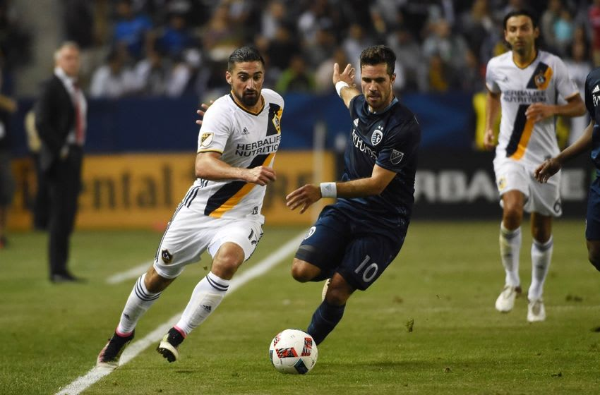 Jun 2, 2016; Carson, CA, USA; Los Angeles Galaxy midfielder Sebastian Lletget (17) and Sporting Kansas City midfielder Benny Feilhaber (10) battle for the ball at StubHub Center. Mandatory Credit: Kirby Lee-USA TODAY Sports