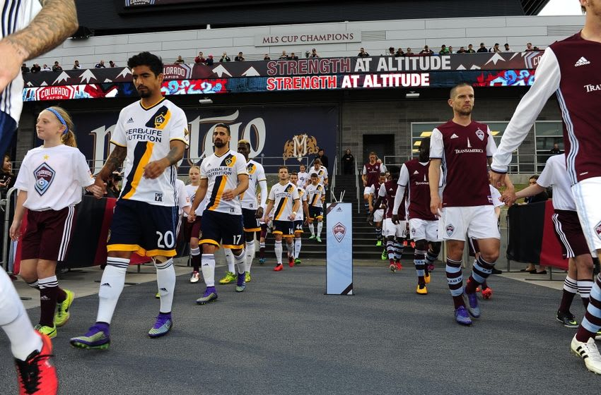 Mar 12, 2016; Commerce City, CO, USA; Members of the Los Angeles Galaxy and the Colorado Rapids head to the pitch before the start of the match at Dicks Sporting Goods Park. The Rapids defeated the Galaxy 1-0 in extra time. Mandatory Credit: Ron Chenoy-USA TODAY Sports