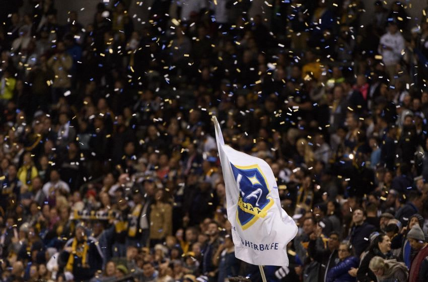 Mar 6, 2016; Carson, CA, USA; The Los Angeles Galaxy flag waves through confetti after a goal off of a penalty kick from forward Robbie Keane (not pictured) during the second half against the D.C. United at StubHub Center. The Los Angeles Galaxy won 4-1. Mandatory Credit: Kelvin Kuo-USA TODAY Sports