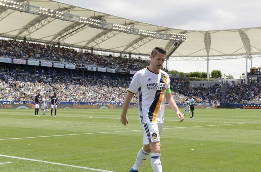 May 8, 2016; Carson, CA, USA; LA Galaxy forward Robbie Keane (7) walks the ball to for a corner kick against the New England Revolution during the first half at StubHub Center. Mandatory Credit: Kelvin Kuo-USA TODAY Sports
