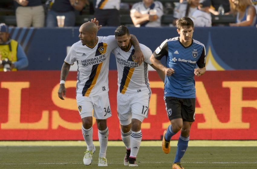 May 22, 2016; Carson, CA, USA; LA Galaxy midfielder Sebastian Lletget (17) celebrates with midfielder Nigel de Jong (34) after an own goal by San Jose Earthquakes defender Marvell Wynne (not pictured) during the second half at StubHub Center. The game ended in a draw with a final score of 1-1. Mandatory Credit: Kelvin Kuo-USA TODAY Sports