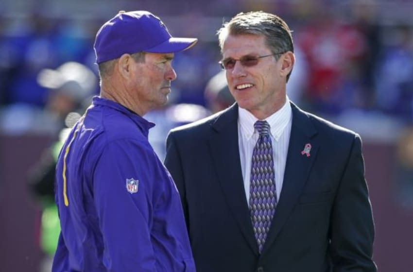 Oct 18, 2015; Minneapolis, MN, USA; Minnesota Vikings head coach Mike Zimmer (L) speaks with general manager Rick Spielman (R) prior to their game against the Kansas City Chiefs at TCF Bank Stadium. Mandatory Credit: Bruce Kluckhohn-USA TODAY Sports