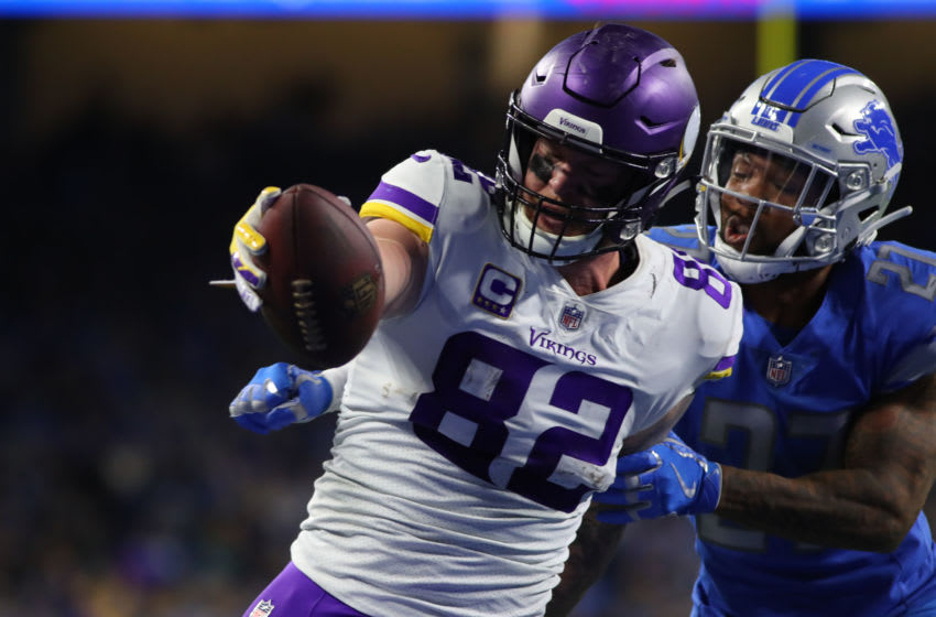 DETROIT, MI - DECEMBER 23: Kyle Rudolph #82 of the Minnesota Vikings scores a touch down in front of Glover Quin #27 of the Detroit Lions in the fourth quarter at Ford Field on December 23, 2018 in Detroit, Michigan. (Photo by Gregory Shamus/Getty Images)