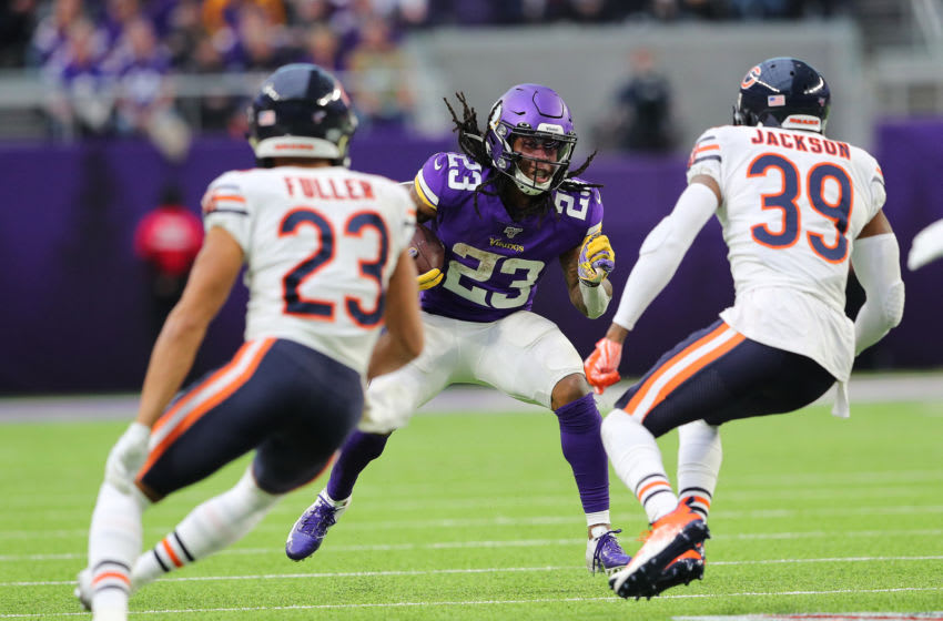 MINNEAPOLIS, MN - DECEMBER 29: Mike Boone #23 of the Minnesota Vikings carries the ball for a first down in the third quarter against the Chicago Bears at U.S. Bank Stadium on December 29, 2019 in Minneapolis, Minnesota. (Photo by Adam Bettcher/Getty Images)