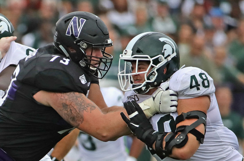 Kenny Willekes #48 of the Michigan State Spartans against Gunnar Vogel #73 of the Northwestern Wildcats (Photo by Jonathan Daniel/Getty Images)