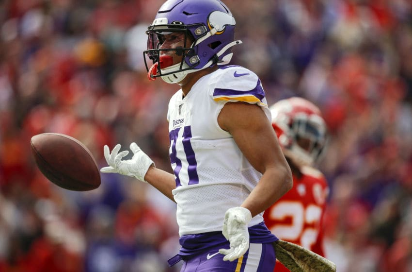 KANSAS CITY, MO - NOVEMBER 03: Bisi Johnson #81 of the Minnesota Vikings flips the football after catching a first quarter touchdown pass against the Kansas City Chiefs at Arrowhead Stadium on November 3, 2019 in Kansas City, Missouri. (Photo by David Eulitt/Getty Images)