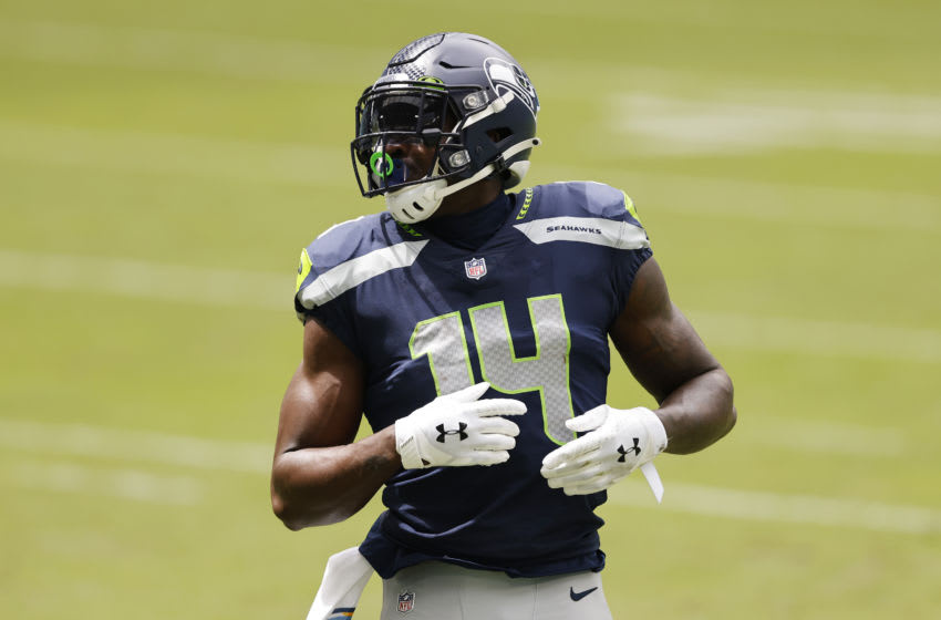 MIAMI GARDENS, FLORIDA - OCTOBER 04: DK Metcalf #14 of the Seattle Seahawks looks on against the Miami Dolphins during the second half at Hard Rock Stadium on October 04, 2020 in Miami Gardens, Florida. (Photo by Michael Reaves/Getty Images)