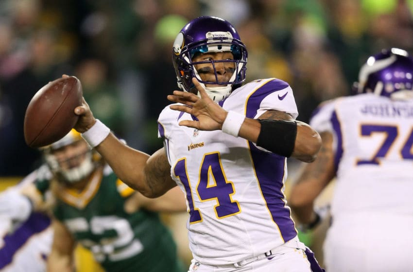 GREEN BAY, WI - JANUARY 05: Quarterback Joe Webb #14 of the Minnesota Vikings throws the ball against the Green Bay Packers in the second quarter during the NFC Wild Card Playoff game at Lambeau Field on January 5, 2013 in Green Bay, Wisconsin. (Photo by Andy Lyons/Getty Images)