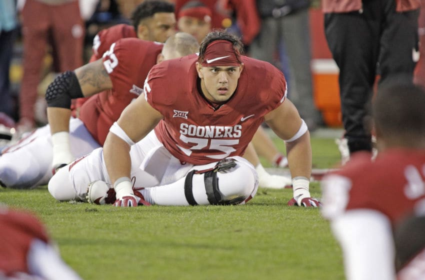 NORMAN, OK - OCTOBER 28: Offensive lineman Dru Samia #75 of the Oklahoma Sooners warms up before the game against the Texas Tech Red Raiders at Gaylord Family Oklahoma Memorial Stadium on October 28, 2017 in Norman, Oklahoma. Oklahoma defeated Texas Tech 49-27. (Photo by Brett Deering/Getty Images)