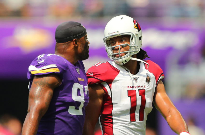 Everson Griffen #97 of the Minnesota Vikings and Larry Fitzgerald #11 of the Arizona Cardinals (Photo by Adam Bettcher/Getty Images)
