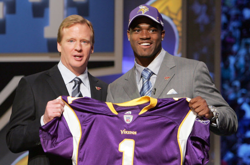 NFL Commissioner Roger Goodell, left, with Adrian Peterson RB out of Oklahoma chosen seventh by the Minnesota Vikings during the NFL draft at Radio City Music Hall in New York, NY on Saturday, April 28, 2007. (Photo by Richard Schultz/NFLPhotoLibrary)