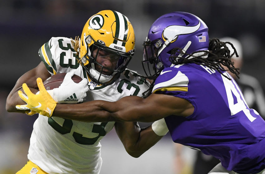 (Photo by Hannah Foslien/Getty Images) Aaron Jones and Anthony Harris