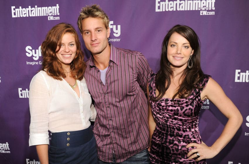 SAN DIEGO - JULY 24: (L-R) Actors Cassidy Freeman, Justin Hartley and Erica Durance attend the EW and SyFy party during Comic-Con 2010 at Hotel Solamar on July 24, 2010 in San Diego, California. (Photo by Michael Buckner/Getty Images for EW)