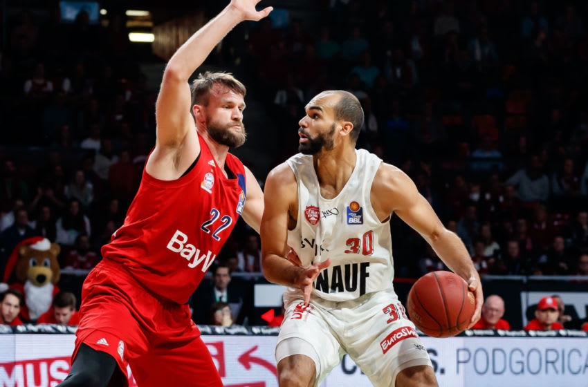 Danilo Barthel of Bayern Muenchen and former Kansas basketball star Perry Ellis of s.Oliver Wuerzburg battle for the ball. (Photo by TF-Images/Getty Images)