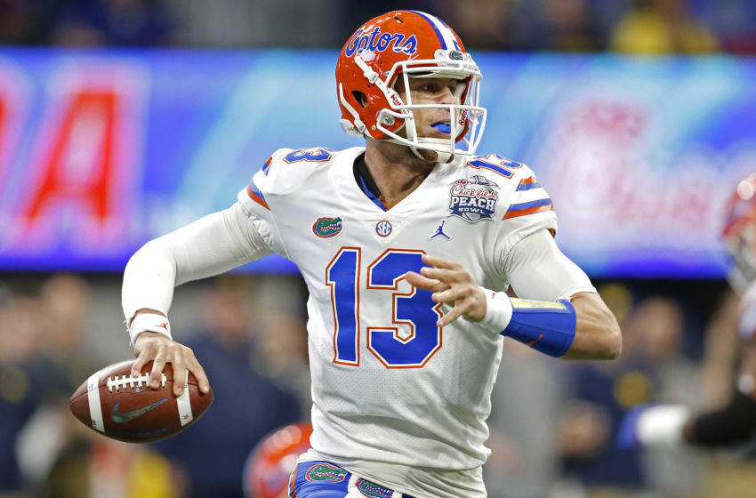 ATLANTA, GEORGIA - DECEMBER 29: Feleipe Franks #13 of the Florida Gators looks to pass against the Michigan Wolverines in the first quarter during the Chick-fil-A Peach Bowl at Mercedes-Benz Stadium on December 29, 2018 in Atlanta, Georgia. (Photo by Mike Zarrilli/Getty Images)