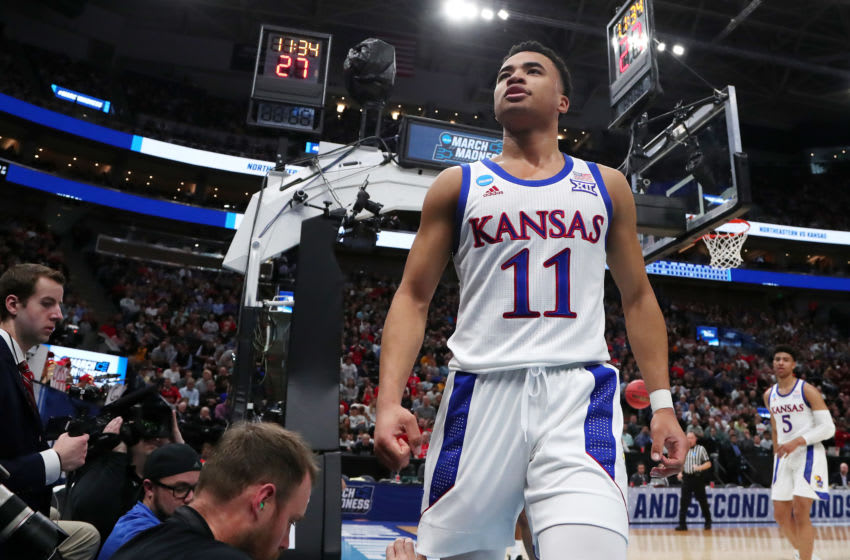 SALT LAKE CITY, UTAH - MARCH 21: Devon Dotson #11 of the Kansas Jayhawks reacts during the first half against the Northeastern Huskies in the first round of the 2019 NCAA Men's Basketball Tournament at Vivint Smart Home Arena on March 21, 2019 in Salt Lake City, Utah. (Photo by Tom Pennington/Getty Images)