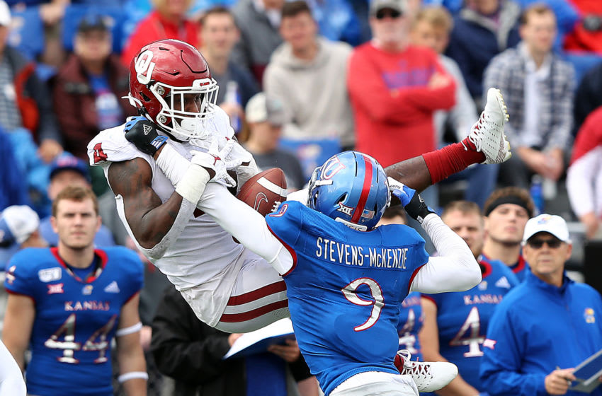 Linebacker Najee Stevens-McKenzie #9 of Kansas football breaks up a pass. (Photo by Jamie Squire/Getty Images)