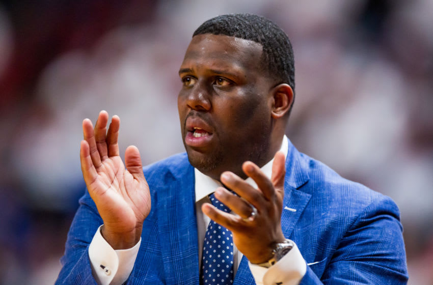 LUBBOCK, TEXAS - MARCH 07: Assistant coach Jerrance Howard of the Kansas Jayhawks claps during the second half of the college basketball game against the Texas Tech Red Raiders on March 07, 2020 at United Supermarkets Arena in Lubbock, Texas. (Photo by John E. Moore III/Getty Images)