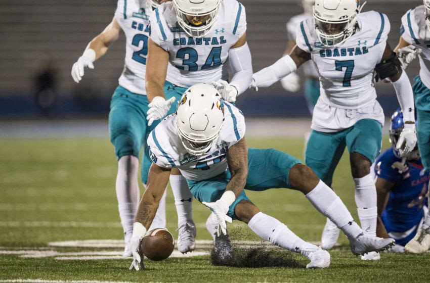 Linebacker Enock Makonzo the Coastal Carolina Chanticleers recovers a fumble during the game against Kansas football. (Photo by Brian Davidson/Getty Images)
