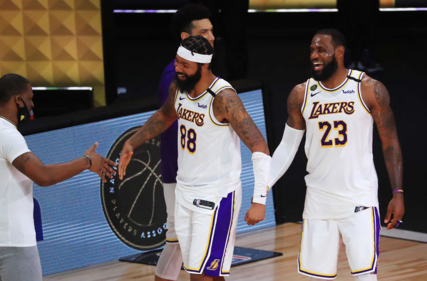 LeBron James of the Los Angeles Lakers reacts with Kansas basketball alum Markieff Morris of the Los Angeles Lakers after winning the 2020 NBA Championship. (Photo by Mike Ehrmann/Getty Images)
