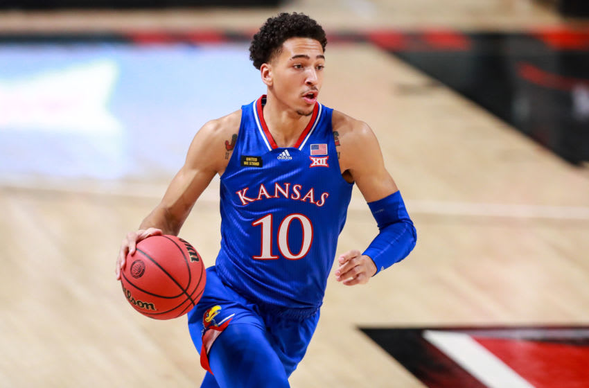 LUBBOCK, TEXAS - DECEMBER 17: Forward Jalen Wilson #10 of the Kansas Jayhawks handles the ball during the first half of the college basketball game against the Texas Tech Red Raiders at United Supermarkets Arena on December 17, 2020 in Lubbock, Texas. (Photo by John E. Moore III/Getty Images)