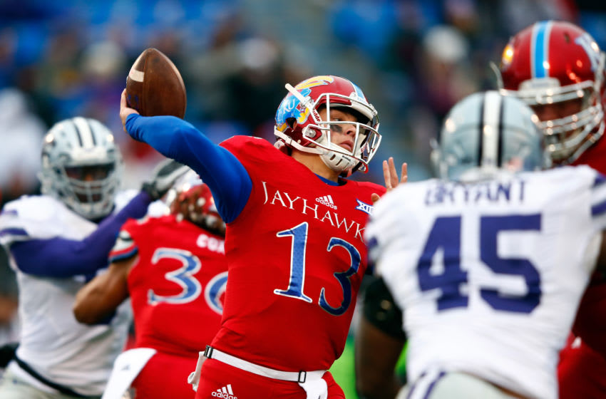 LAWRENCE, KS - NOVEMBER 28: Quarterback Ryan Willis #13 of the Kansas Jayhawks passes during the game against the Kansas State Wildcats at Memorial Stadium on November 28, 2015 in Lawrence, Kansas. (Photo by Jamie Squire/Getty Images)