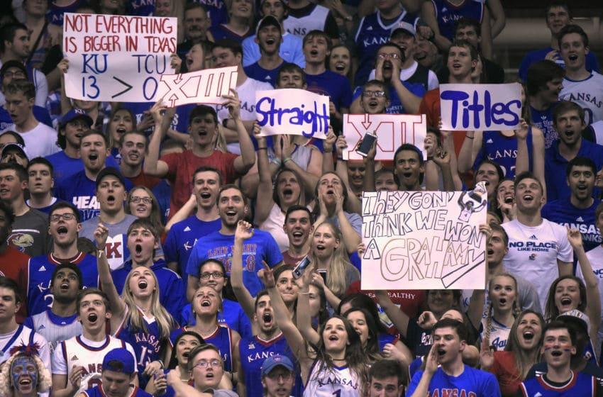 LAWRENCE, KS - FEBRUARY 22: Kansas Jayhawks fans hold up signs as Kansas prepares to win their 13th straight Big 12 Conference Championship during a game against the TCU Horned Frogs at Allen Fieldhouse on February 22, 2017 in Lawrence, Kansas. (Photo by Ed Zurga/Getty Images)