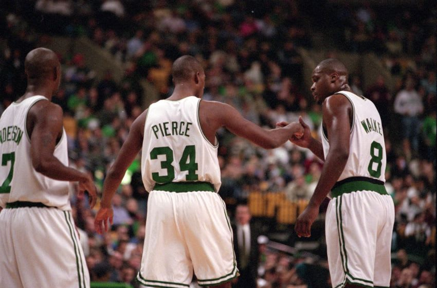 Kenny Anderson #7, Antoine Walker #8, and Paul Pierce #34 of the Boston Celtics celebrate. Mandatory Credit: Ezra O. Shaw /Allsport
