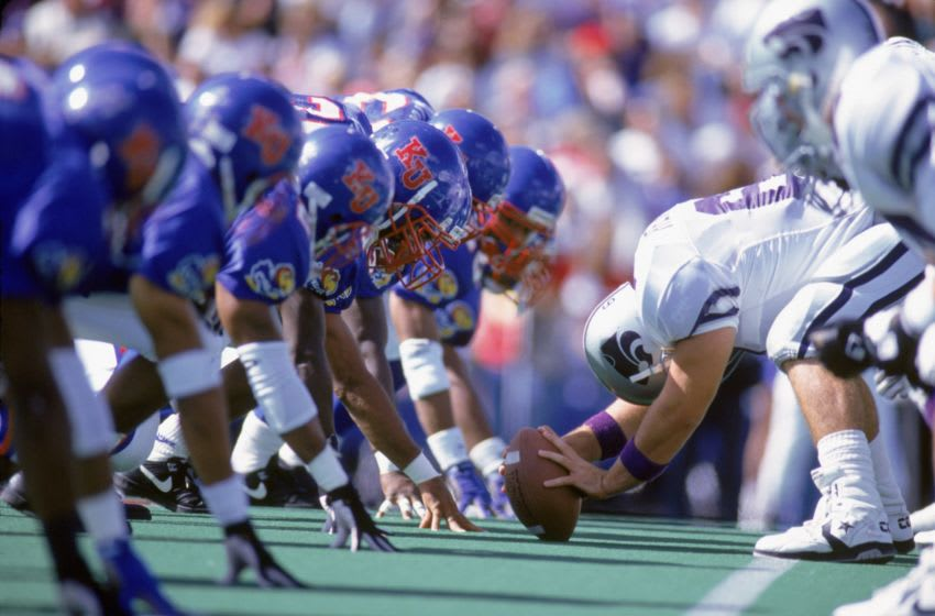 The Kansas football defense lines up at the line of scrimmage during the game against the Kansas State Wildcats. (Photo by Bernstein Associates/Getty Images)