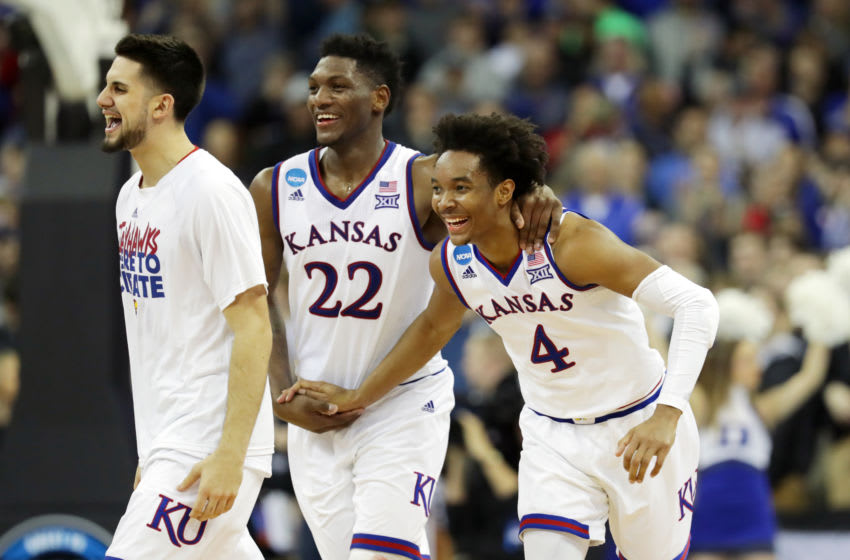 Silvio De Sousa #22 and Devonte' Graham #4 of Kansas basketball celebrate after their team defeated the Duke Blue Devils. (Photo by Streeter Lecka/Getty Images)