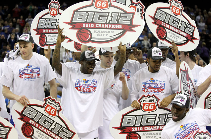 Kansas basketball celebrates with championship banners after defeating the Kansas State Wildcats to win the 2010 Phillips 66 Big 12 Men's Basketball Championship. (Photo by Jamie Squire/Getty Images)