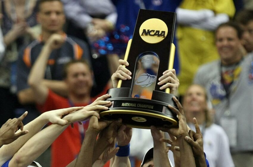 SAN ANTONIO - APRIL 07: The Kansas Jayhawks celebrate after defeating the Memphis Tigers 75-68 in overtime during the 2008 NCAA Men's National Championship game at the Alamodome on April 7, 2008 in San Antonio, Texas. (Photo by Jed Jacobsohn/Getty Images)