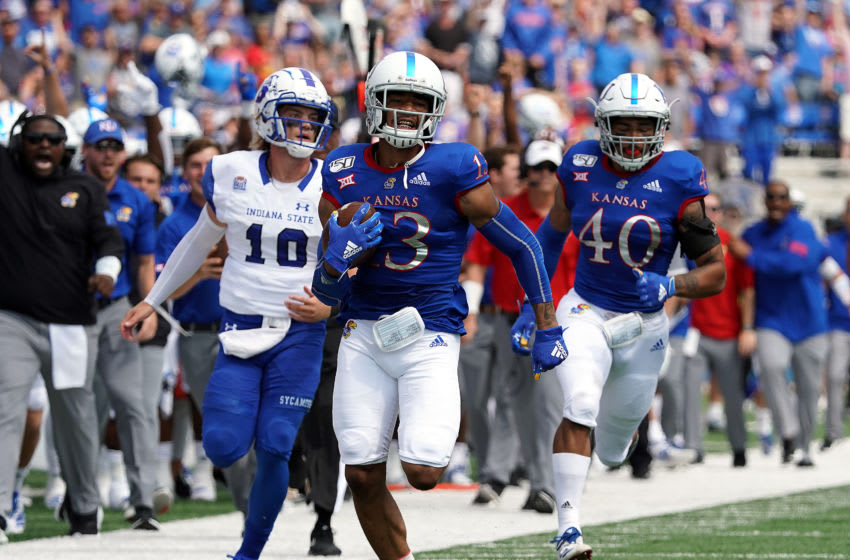 Cornerback Hasan Defense #13 of Kansas football scores a touchdown on an interception. (Photo by Jamie Squire/Getty Images)