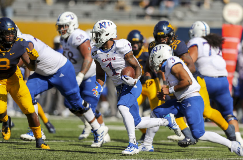 Kansas football running back Pooka Williams Jr. (1) runs the ball during the first quarter against the West Virginia Mountaineers . Mandatory Credit: Ben Queen-USA TODAY Sports