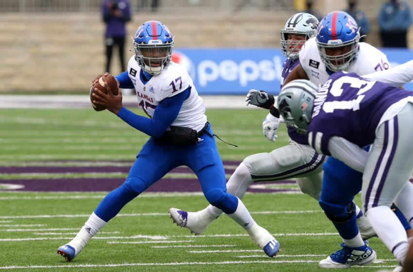Oct 24, 2020; Manhattan, Kansas, USA; Kansas Jayhawks quarterback Jalon Daniels (17) looks for room to run during the first half of a game against the Kansas State Wildcats at Bill Snyder Family Football Stadium. Mandatory Credit: Scott Sewell-USA TODAY Sports