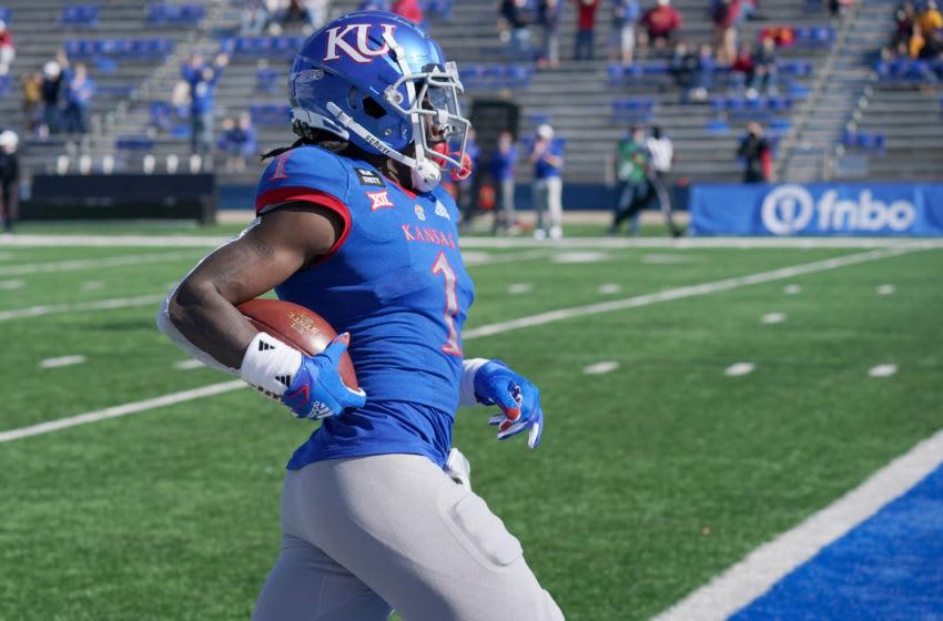 Kansas football safety Kenny Logan Jr. (1) returns a kickoff for a touchdown. Mandatory Credit: Denny Medley-USA TODAY Sports