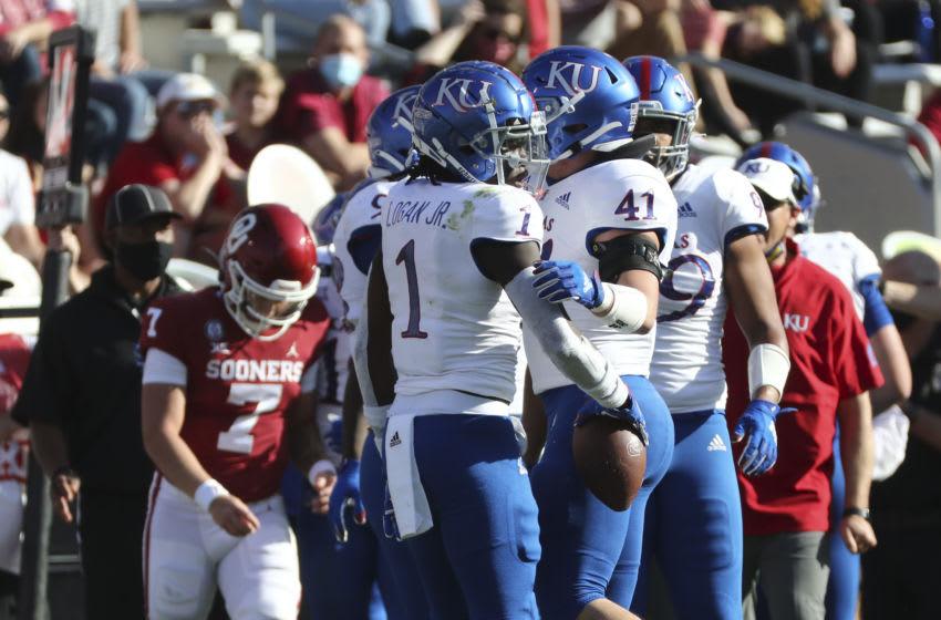 Kansas football safety Kenny Logan Jr. (1) reacts after an interception against Oklahoma Sooners quarterback Spencer Rattler (7). Mandatory Credit: Kevin Jairaj-USA TODAY Sports