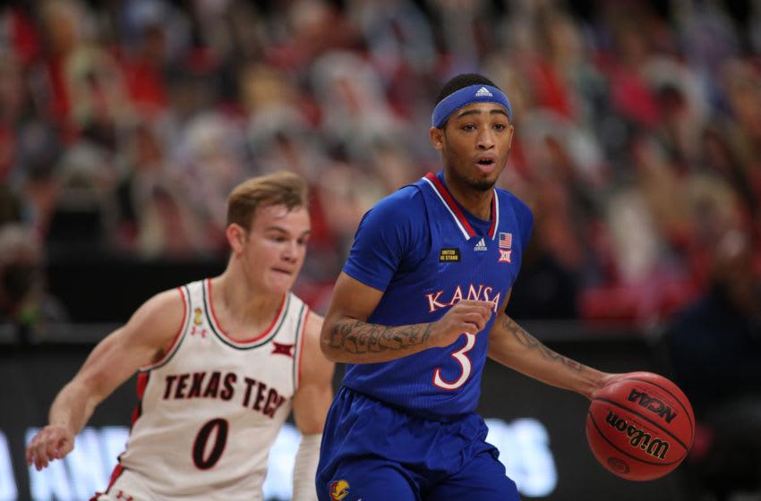 Kansas basketball guard Dajuan Harris Jr. (3) works the ball against Texas Tech. Mandatory Credit: Michael C. Johnson-USA TODAY Sports