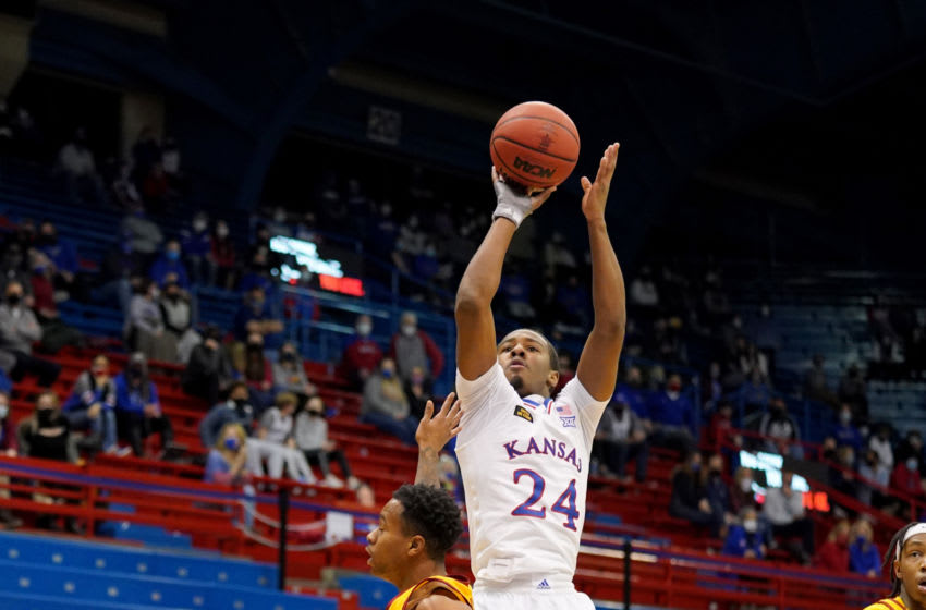 Feb 11, 2021; Lawrence, Kansas, USA; Kansas Jayhawks guard Bryce Thompson (24) shoots over Iowa State Cyclones guard Tyler Harris (1) during the first half at Allen Fieldhouse. Mandatory Credit: Denny Medley-USA TODAY Sports