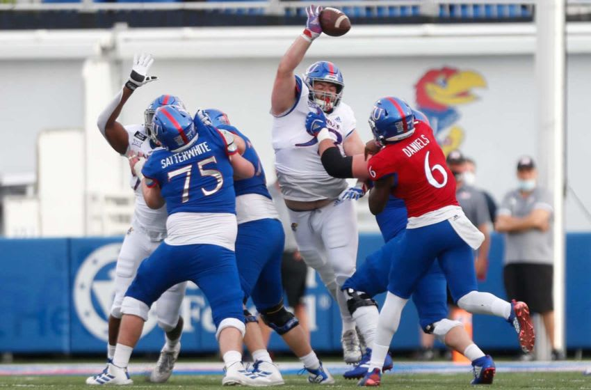 Kansas senior defensive end Sam Burt tips sophomore quarterback Jalon Daniels' pass in the first quarter of Saturday's spring game scrimmage at David Booth Kansas Memorial Stadium in Lawrence.