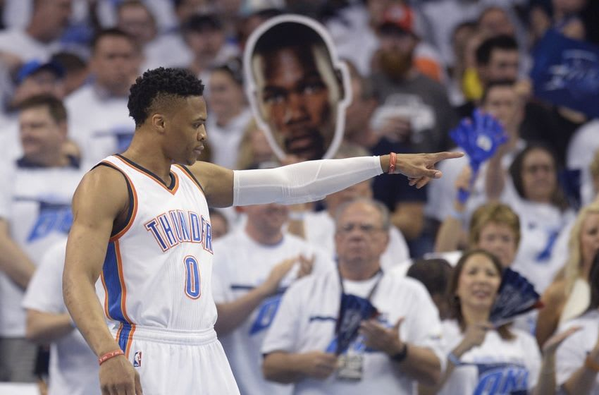 May 22, 2016; Oklahoma City, OK, USA; Oklahoma City Thunder guard Russell Westbrook (0) point before the game against the Golden State Warriors in game three of the Western conference finals of the NBA Playoffs at Chesapeake Energy Arena. Mandatory Credit: Mark D. Smith-USA TODAY Sports
