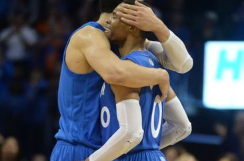 Dec 25, 2016; Oklahoma City, OK, USA; Oklahoma City Thunder center Enes Kanter (11) hugs guard Russell Westbrook (0) after a play against the Minnesota Timberwolves during the fourth quarter at Chesapeake Energy Arena. Mandatory Credit: Mark D. Smith-USA TODAY Sports