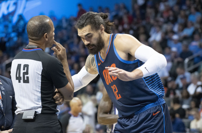 Steven Adams #12 of the OKC Thunder argues a foul call with referee Eric Lewis #42. (Photo by J Pat Carter/Getty Images)