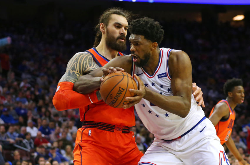Joel Embiid #21 of the Philadelphia 76ers drives to the basket as Steven Adams #12 of the OKC Thunder defends. (Photo by Rich Schultz/Getty Images)