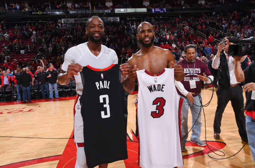 OKC Thunder : Chris Paul #3 and Dwyane Wade #3 of the Miami Heat pose for a photo after exchanging jerseys (Photo by Bill Baptist/NBAE via Getty Images)