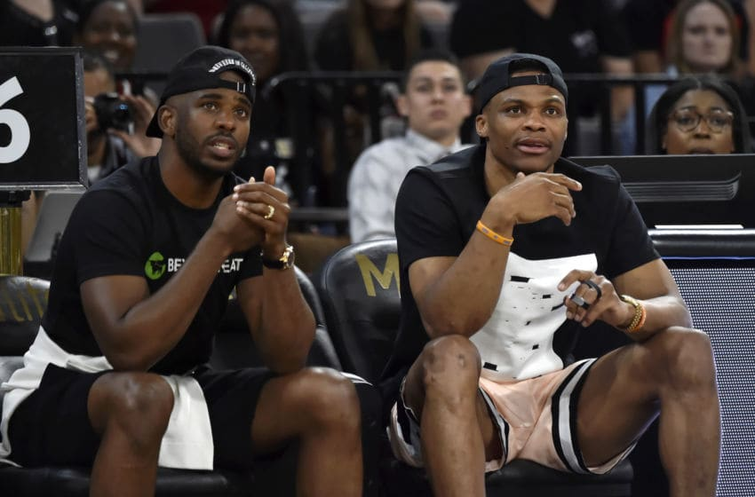 OKC Thunder: Chris Paul #3 and Russell Westbrook #0 attend a game (Photo by David Becker/NBAE via Getty Images)