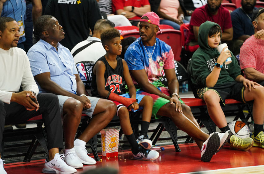 OKC Thunder: Chris Paul (R) and son Chris Paul Jr sit court side watching games at NBA Summer League on July 08, 2019 in Las Vegas, Nevada. (Photo by Cassy Athena/Getty Images)