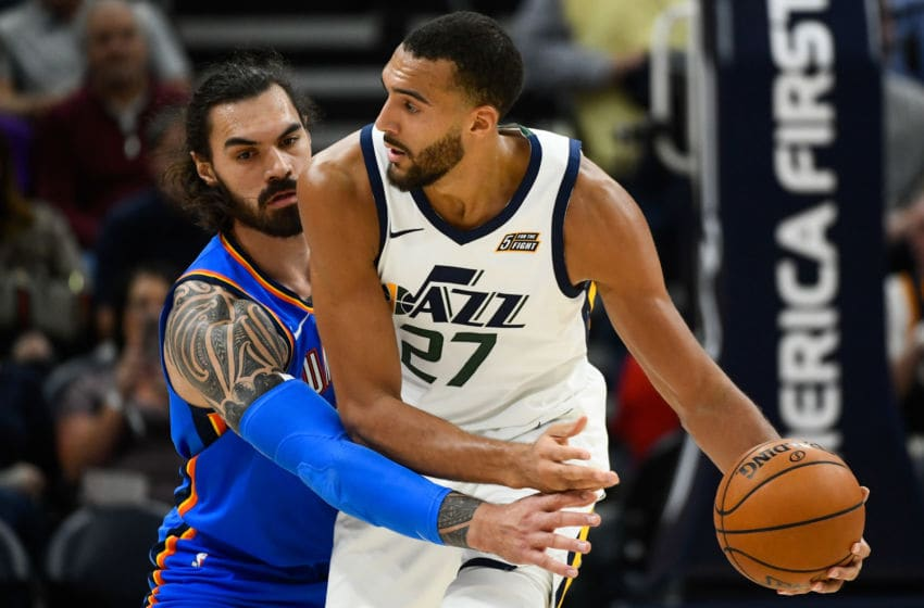 OKC Thunder: Steven Adams #12 guards Rudy Gobert #27 of the Utah Jazz during an opening night game (Photo by Alex Goodlett/Getty Images)
